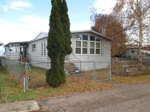 This newly remodeled home has an open floor plan, 2 bd., 2 ba. Large living area with pellet fireplace. All new floor coverings throughout, new kitchen cabinets & countertops. Family room attached to kitchen. Large hobby/bonus room that attaches to the double garage. Windows have been replaced w/energy efficient thermal panes. Newer energy efficient furnace. RV parking, fenced & landscaped yard. Newer heat pump system w/central air. 55+ community south of Kalispell! This is a must see. Call Janeen (406) 250-1333 or your real estate professional for a showing.