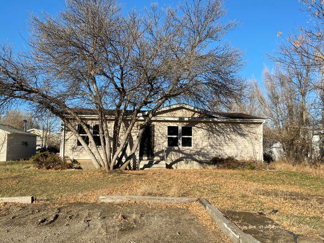 Welcome to Washington Street! This residence offers endless potential as a home to put your personal spin on or an incredible investment to profit from the rental income. The market is in constant demand for rentals in Fort Benton. What's more is fresh paint, new flooring, and new carpeting were just completed! The sunlight beaming down from the two skylights in the kitchen enhances the fresh flooring. The large windows throughout open the space presenting an inviting glow. A vaulted ceiling in the living room adds to the warm ambiance. Revel in the spacious private back deck where you can unwind and relax while entertaining! There is tons of storage and a shed in the back yard. Park your toys, camper, or RV in all the additional parking room. This abode offers more than just a place to call home; with so many endless options, you can add value or add to your income!