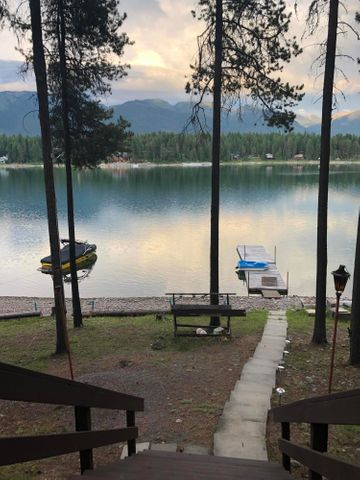 This is a great affordable way to be on the water!  Lease the land and own the improvements with a possibility to purchase the land at a later date.  This great spot on Echo Lake will provide lots of fun and great memories! Over 158 feet of great frontage in a nice bay with nice views.  Remolded in 1998, this well kept Cabin has a warm feel, one bedroom, one full bath plenty of extra sleeping area and a screened in porch.  Nice deck for outdoor entertaining.   Includes several furnishings and dock, just bring some personal items and a water craft and you are set to go!!  Lease information in documents.
