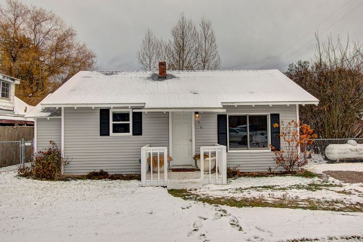CHARMING RONAN HOME.  Single level, 2 bedrooms and 1 bath.  Nice flow with open kitchen design, indoor stackable laundry and separate pantry area.  Updated roof, electrical and plumbing apprx 6 years ago. Fully fenced backyard.  Mature trees, gorgeous lilac bushes, green grass and open space with the neighboring back yard provides enhanced, in-town privacy.  On-street parking and two off street parking spaces.  Appears to be a quiet neighborhood location.  Cozy, well maintained and move-in ready.  Qualifies for zero down financing and low interest rate 30 year financing.  A great starter home. Tours available upon short notice.  Call David Passieri, 406-370-6500, or your real estate professional.