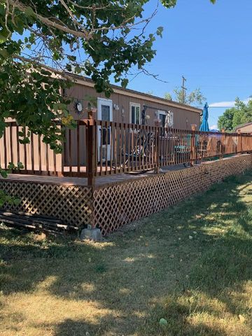 Move-in ready home in Valier MT.  This property features 3 bedrooms, 2 baths, main floor laundry, wrap around deck, fenced yard, and storage shed.  Included in the bedrooms is a master bedroom and bath.  The house has a newer metal roof and a pellet stove for those cold winter nights.  Enjoy the mountain and lake views while relaxing and entertaining on the deck.  If fishing is your hobby, Lake Frances is within walking distance.  This home could be a seasonal home or wonderful full time home.  Glacier Park is about 60 miles away.  Call Lacetta Isenberg, 406-788-1583, or your real estate professional for your showing today.