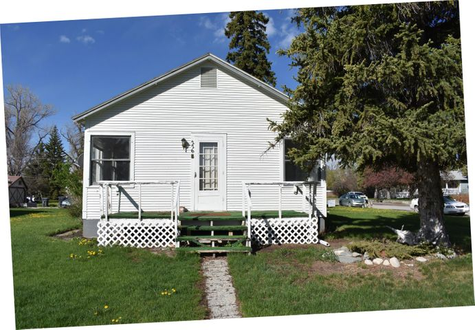Two homes for the price of one! Located on a large corner lot, 100 ft x 120 ft, with mature trees, both of these homes are single bed, single bath and situated ideally for rental properties.  OR...live in one and rent out the other.  Perhaps your family member needs to be close?  Second house is concrete block construction.  It is 560 s.f. one bedroom and 1 bath with a mud/laundry room on the back.   Comes with a detached storage shed. Don't let this investment property pass you by!  Call Phyllis Bechtold at 406-799-7222 or your real estate professional to schedule a showing.