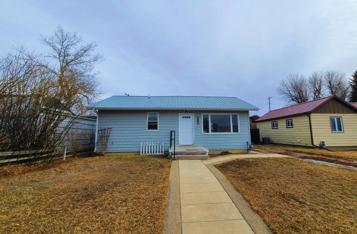 This single level 3 bed 2 bath home has lots to offer! New flooring throughout the 1382 +/- Sq. Ft. home, a large kitchen with skylight makes a bright cooking space. The large open floor concept between the living and dining room will make entertaining a breeze. 2 bedrooms and 3/4 bath at the front, and a large master suite in the rear of the home. There is also a potential 3rd sleep space for more privacy with the loft above the garage! Electrical has been installed and is ready to be finished to your heart's content.  Storage shed in the fenced back yard, as well as a great deck for BBQ's or relaxing on a quiet evening. Close to schools and hospitals, you don't want to miss this home!  Don't forget to check out the virtual tour, with floorplans available!