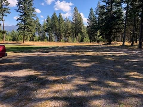 Beautiful lot in Finley Point with a mobile home and garage! The mobile home could possibly be renovated, or moved! Great potential with underground sprinklers already in place and a garage! Call Amber Isbell 406-951-0849, or your real estate professional!