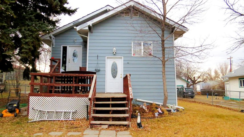 Great multi-level home to fit your budget! A total of 5 bedrooms and 2 baths, full egress basement, fenced yard and off street parking. 2 beds, 1 bath, large laundry room, formal dining, galley style kitchen with newer appliances and lots of cupboard space on the main level. The lower level has 3 bedrooms, 1 bath, large family room, exercise room and utility room as well as large egress windows throughout. Baseboard heat throughout, plumbing available in basement for 2nd laundry area or kitchen. Back yard features a 440 sq. ft. storage building ,off street parking, 200 sq. ft. back deck, and private firepit area. Call your local Real Estate Professional today!