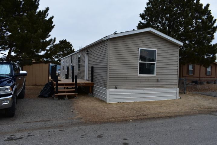 Fully remodeled mobile (inside and out) in Leisure Village.  2012 Friendship model, 3 bedroom, 2 bath, all new appliances, cabinets and flooring.  New deck. partially fenced yard.  Must see.  Call David Brandon at 406-594-9121 or your Real Estate Professional.