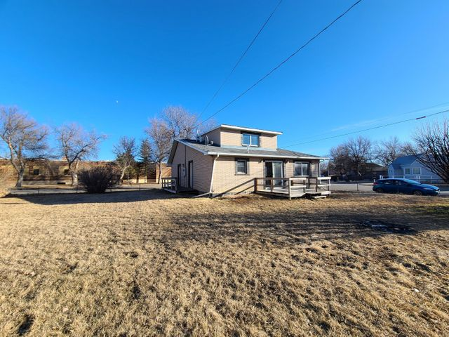 Updated Single Family Home on Corner Lot! sprinkler system, GFA/AC, and main floor living are a few features of this cute home! 2,312 +/- sq. ft. living space, featuring updated kitchen, main level laundry, 2 beds and a full bath with open floor plan to kitchen, living and dining. 2nd level has been updated to a great 3rd bedroom/ full bath with large closet. Basement is present with  exterior entry, easy access to plumbing and electrical and great space for storage. Fully fenced 11,000 sq. ft. lot! newer lighting, neutral colors, and move in ready! Virtual Tour available as well as estimated Floorplans. Call Mikayla Jordan-Garcia today at 406-450-1281 or your real estate professional!