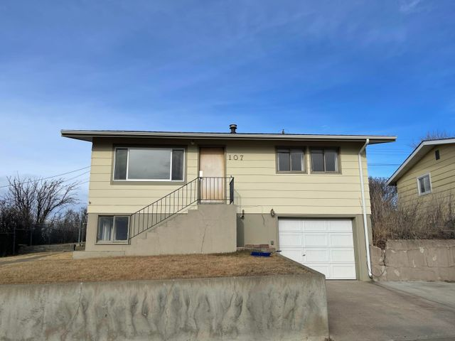 Move in ready and priced to sell. View of the Rocky Mountain Front. Main level consists of living room, eat-in kitchen, 2 bed & 1 bath. Hardwood floors throughout most of the main level. Lower level consists of a bedroom, office or bedroom, 3/4 bath with stackable w/d hookups. Attached garage with storage. Updated kitchen cupboards, counter and flooring. New roof. Furnace 2 years old.  Call Jessica Hedges at 406-845-3156, or your real estate professional.