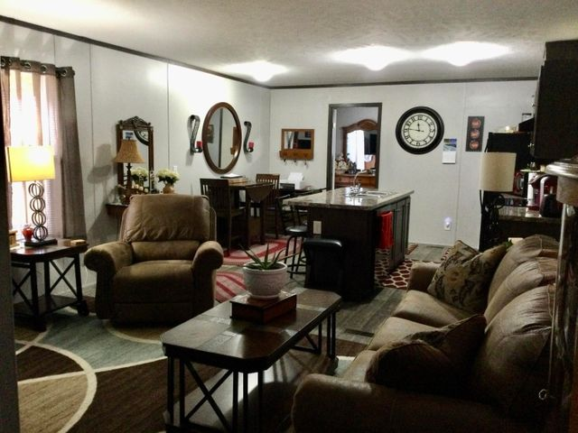 NOW WITH A BRAND HIGH QUALITY ROOF! You don't want to miss this opportunity to own this 2020 16x70,  3 bedroom 2 bath home on a rented lot in Leisure Village.  The open floor plan and covered deck are great for entertaining your friends and family. Enjoy the amenities of Leisure Village including multiple parks, a pool and gym! Buyer must be approved by Leisure Village prior to closing. Call or text Darcy LaFloe at 406-431-6060, or your real estate professional for a showing.