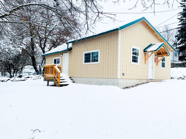 Completely remodeled 1 bedroom, 1 bath home close to all your town amenities!  Walk into this cute little home into a large living/dining room having a vaulted ceiling and lots of windows for light as well as views of the mountains and Clark Fork River out your dining room window.  The kitchen has all new cabinets,  countertops, appliances, sink & fixture as well as flooring! Walk into a large laundry room that splits to take you to the full bath and the master bedroom.  This 1000 sq foot home is basically  brand new, to include all new wiring, siding, roof, gutters and a small deck off the south side with trex decking.  Heated by a wood stove and electric wall heaters! (Outside of home will be painted when weather permits)