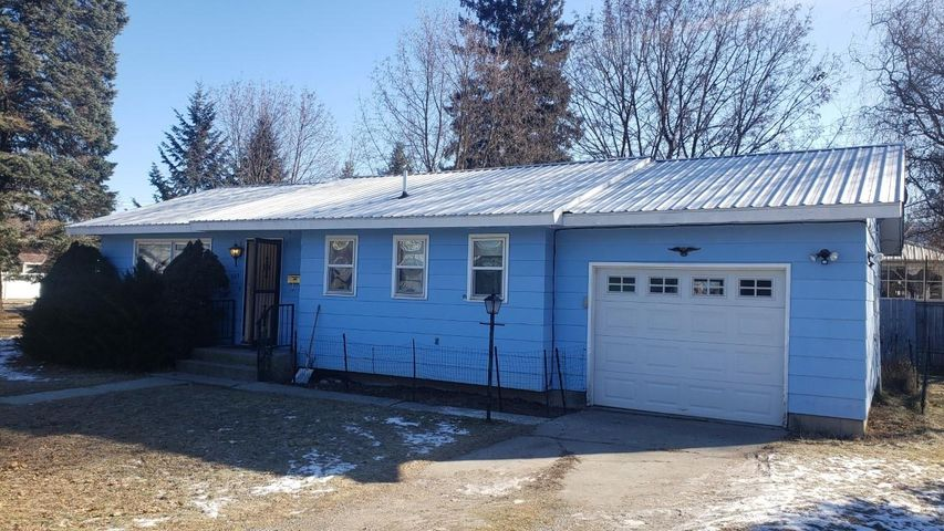 This cozy home is located on a corner lot and  has easy one level living  The home has 2 bedrooms and 1 bath, and a nice size living room.  There is a corner dining area and galley kitchen which adjoins the walk out utility room. Included in the sale are the range, refrigerator, washer and dryer!  The attached single car garage also gives you access to more storage.  Call to see this home today! Call Debra Cernick at 406-291-0829, or your real estate professional.