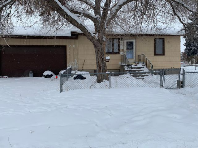 Investors special! Check out this three bedroom, two bathroom home with an additional office space and lots of storage. This house is located on a huge corner lot in a central location and is zoned R-2. The possibilities are endless! This home needs some work and has some unrepaired fire damage along with other needed maintenance items. Lots of off street parking and a fenced yard!  No VA, FHA financing. Call Brittney Buchanan at 406-209-3696 or your real estate professional for more details.
