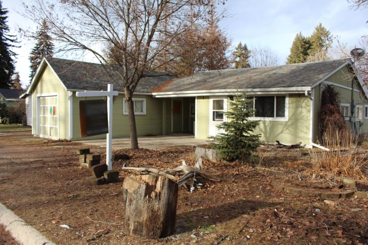 This charming 3bed/1bath is move-in ready.  The home offers convenient single level living in close proximity to town amenities.   The interior has been brightened and rejuvenated with fresh paint, new doors, and new floor coverings.   Ample covered storage and workspace is provided with an attached garage and detached shop.  The property's spacious lot is chain-link fenced and includes a fenced garden area and RV Parking.  Schedule your showing today.