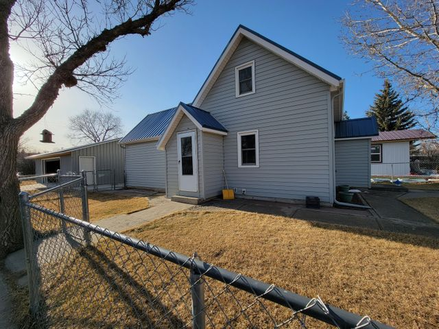 Updated 2 bed 1 bath home with single level amenities. Newer seamless siding, roof & gutters, carpet, and an addition built on the main level in 2015. 1 bed on main level, 1 bed in 2nd level. Detached 2 stall garage and fenced yard all on a corner lot close to hospital and downtown shopping. Call Mikayla Jordan-Garcia 406-450-1281 or your real estate professional today!