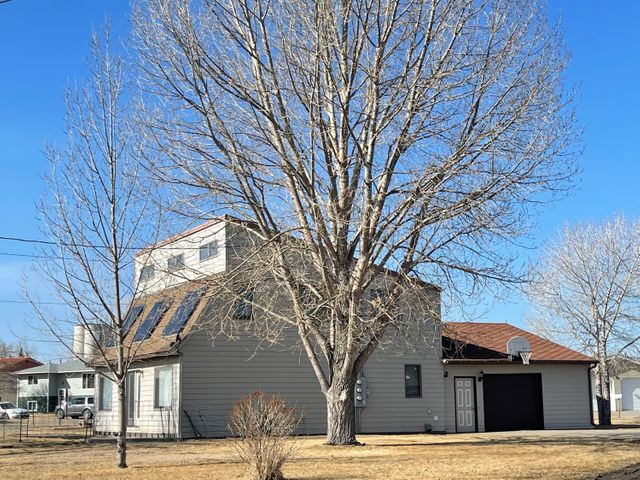 Unique energy efficient home sitting on a double corner lot. Sauna & 2 Sun rooms. Main level has family room, dining area, kitchen, sunroom with sauna, 3/4 bath, laundry. Upstairs has 2 bedrooms and a full bath; Master suite with 3 closets and a full bath. 2 of the 3 bedrooms have sliding doors to the sunroom upstairs. Attached garage with garage doors on each side of the garage. Room for storage. Large yard, Off Street parking. Home has a recirculation unit to circulate the air through the home. Call Jessica Hedges at 406-845-3156, or your real estate professional.