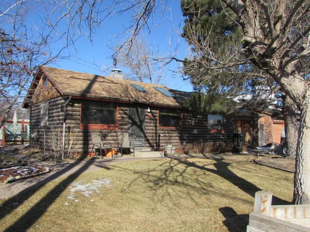 Amazing house with one bedroom and sleeping loft. Plus great little office/study room. Hardwood floors, many built-ins, unique lighting and two skylights. So many charming features you need to see for yourself!! Beautifully landscaped yard and backyard patio to enjoy those spring and summer days right around the corner.  Furnace and central air approximately 7 years new.!! 200 AMP service and attached work shop. Wonderful patio area and decorative landscaping. New roof in 2015. Call Travis Manus 406.590.4965 or your Real Estate professional.