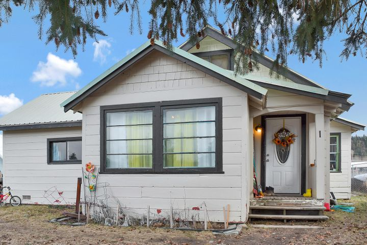 Charming 3 bedroom/1 bath home located on a quiet street with a spacious, fully fenced backyard perfect for outdoor entertaining. Inside features a open living room, ample sized bedrooms, large kitchen with generous storage and breakfast nook. A mudroom/laundry room is directly off the kitchen with easy access to the backyard. The home is close to the athletic club, tennis courts and other local amenities. Schedule your showing today! Call Angela Vande Garde at 406-291-9893, or your real estate professional.