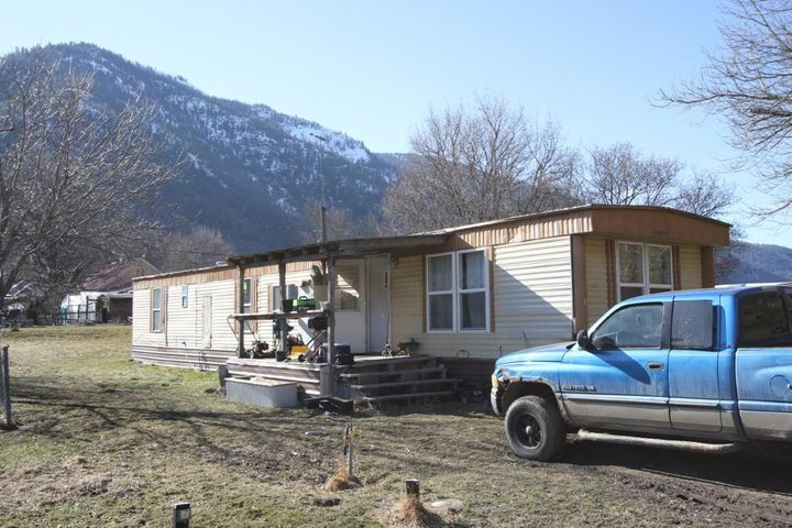Affordable Housing in Paradise, Montana.  There is plenty of room in this  2 bedroom, 1 bath singlewide home.  Located in the nice, quiet town of Paradise, Montana.  Just a hop, skip and jump from Plains.  Watch the Big Horn Sheep on the hills outside your living room windows.  The covered front deck provides shelter over the front door.  There is a large living room and a large kitchen that offers a nice space for your family.  The master bedroom is at the end of the hallway and has a separate access to the bathroom.  The guest room is adequate and the washer/dryer hookups are conveniently located in the hallway.  Come and look at all the potential that this property has to offer. Contact Deb Warren at 406-544-5971 or your real estate professional.