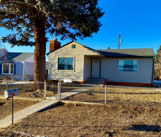 Welcome home and enjoy simplistic living in this 2 bed, 1 bath home with a fenced yard.  This home features hardwood floors, lots of natural light, open concept, and Move-in condition.  Located one block from Whittier Elementary School and near East Junior High.  Schedule a private tour today!  Easy access to the freeway. Nearby amenities are Maud S Canyon Hiking Trail, Homestake, Delmo Lake, and dog park with a fishing pond for the kids. Call Jen Jollie at 406-498-5035, or your real estate professional.