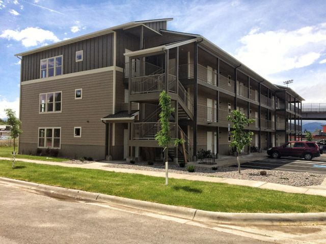 Easy living at the Iron Horse Condos.  Units is custom built one bedroom/one bathroom 730+ sqft condominium featuring corrugated metal exteriors accented with stone and hard board siding. Wood accent vinyl flooring throughout the unit. Custom alder wood cabinets, granite counter-tops in kitchen. Stained wood trim, clean white walls, with covered concrete deck. Laundry closet and large storage closet included. High efficiency electric heat and air conditioning. Great location. Walking and biking distance from Lowell Elementary School, shopping, downtown and the University of Montana. Convenient access to Mountain Line bus stop.  Call or text Curtis Strohl at 406-546-5359, or your real estate professional.