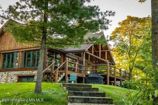 Cedar log home on 10.28 acres with 652 feet of shoreline on Pickerel Lake.