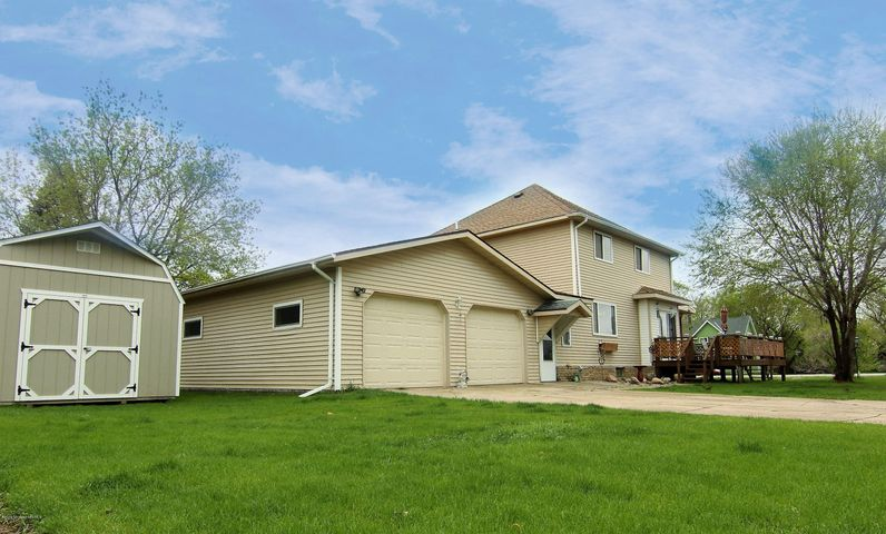 EXTERIOR OF HOME WITH ATTACHED GARAGE AND 12X20 STORAGE SHED