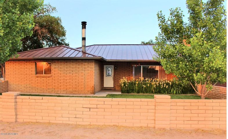 Beautiful brick home with landscaped, yard