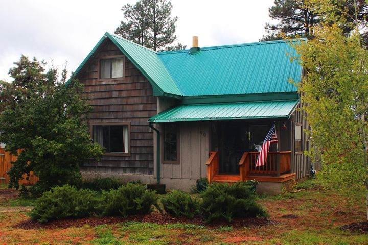 How cute is this 1745 Square foot home? You'll never have to replace the roof!