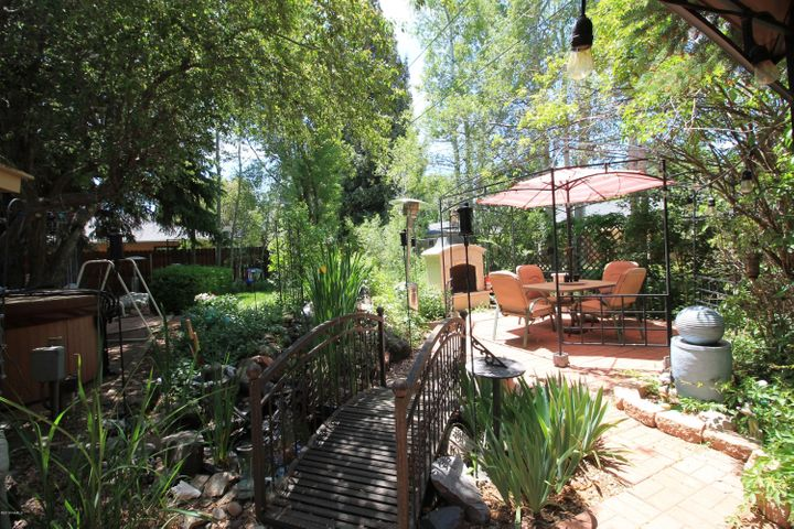 Fabulous backyard with a pond and waterfall. Outdoor fireplace. Green House and jetted tub