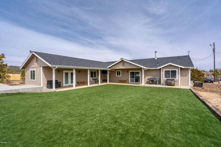 Two double doors onto large covered patio out to the year round beautiful green yard. Easy maintenance, lots of fun space