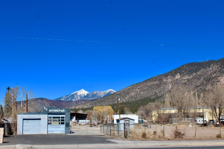 Three parcels totaling 3.97 acres; level, at grade, with peaks view in the City of Flagstaff.