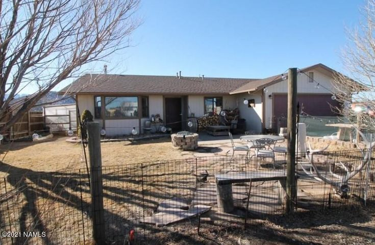 Single level 3 bedroom ranchette on 2.77 acres. Move in ready