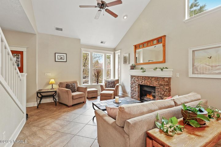 Livng room with fireplace and vaulkted ceilings.