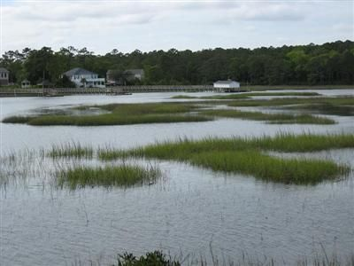 Beautiful Big WATERFRONT lot approx. .75 ac, & having over 213 feet of water frontage on the Little Shallotte River with waterfront views all the way to the Big Shallotte River. Spectacular incredible homesite offering salt water velvet breezes & minutes to ocean. Oyster Harbour is gated private waterfront community. Low property taxes $403.00 year. POA dues only 1,016 year & give you so many community amenities: private gated community, private boat launch on Intracoastal Waterway overlooking Holden Beach, Private pier on ICW with several Day docks & lovely Gazebo,2 private boat storage areas,canoe pier on saltwater Big Shallotte River, pier & Gazebo on natural fresh water Hewett's Lake, pool-clubhouse-tennis-parks-nature trails & more!Priced to sell !!