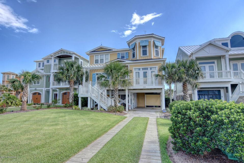 MAGNIFICENT EXCEPTIONAL WATERFRONT BEAUTY! Coastal Living Magazine would love to feature this gorgeous Waterfront Beach Cottage.  Professionally decorated by Interior Decorator.4 bedrooms with 2 flex rooms/offices. Used as 6 bedrooms.This is Perfection at it's finest. Home comes completely furnished,all accessories, lamps, light fixtures, rugs, bed linens, exquisite matching window Treatments,dishware, glassware & silverware, all appliances convey. Brazilian Cherry Hardwood Floors,& beautiful custom tile work,5 full bathrooms with bidet toilets in each, elevator,solar heated pool, exercise room with sauna, hurricane shutters for all windows, deep water pier on Jinx Creek Lagoon, Flood insurance under 700., Spectacular waterfront views from covered Front & back porch. All this and heaven to