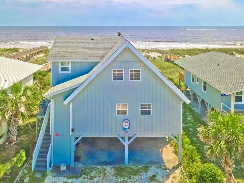 Affordable new price! Beach-front property's potential is almost as endless as the views out to sea!  Older cottage has been a much-loved family retreat for years and has lots to offer a buyer, whether investor or second home seeker.  Atypical floor plan features a living space with soaring ceiling and plenty of glass from which to enjoy the ocean vista, with a low-maintenance deck across the rear.  Second floor loft provides another living area with additional storage.  Non-conforming flex room on the ground floor with half bath can easily serve as an extra bedroom or den, and has its own covered adjacent deck.  And, there's an elevator to the main living floor to boot!  Enclosed outside shower and walkway to the beach complete the package. So many possibilities, see it today!