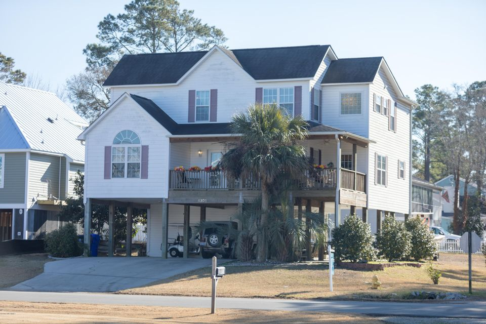 Beautiful 4 bedroom, 3-1/2 bath home on corner lot on Oak Island with views of the ICW. Kitchen and dining room combo with bar for extra seating. Long living room opens to small deck facing the waterway. Kitchen remodel and hardwood flooring in great room done in 2017. Upstairs master has walk in shower as well as jetted garden tub. Large outdoor shed and plenty of parking under home. Parking area could be turned into entertainment area. Home is centrally located to shopping, downtown Southport, and, of course, the beach.