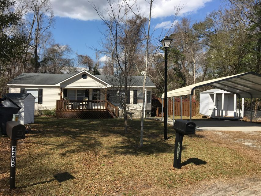 Really Lovely  3 bedroom double wide home. Located on a large fenced yard on cul da sac. Living room, gxreat kitchen, all appliances, carport, storage shed. NICE! Welcome Home!