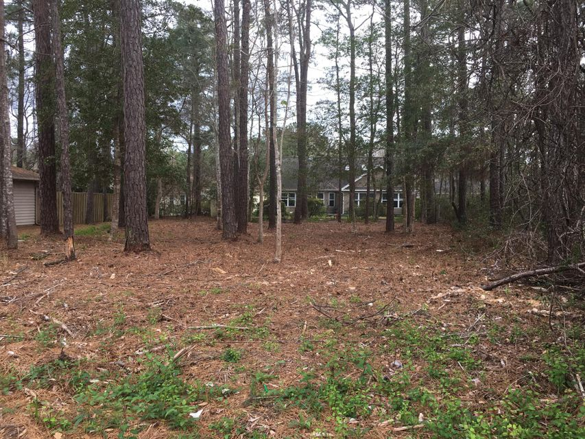 Lovely wooded lot just one lot from the Golf Course. Located on a quiet cul da sac. A perfect building lot for your home. Water and Sewer. Convenient to shopping, the beaches, golf, restaurants, and the quaint seaside town of Calabash.