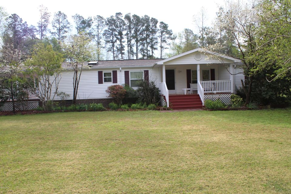 Great Country Home! Three bedrooms two full baths. Has a large 28 X 34 two car garage with a full kitchen,with heat and air, inside storage room, outside storage shed.Also has an open shed for boat or RV. Nice private setting