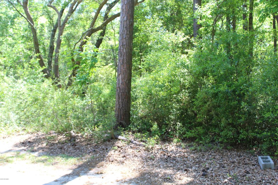 Wooded home site in River Bluff Estateslocated at end of cul-de-sac on Red Berry Court. Near community boat launch,dock, pool and community garden. Beautiful views of Shallotte River fromcommunity dock.