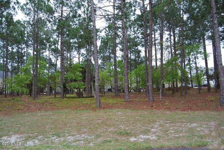 Beautiful wooded lot in the Lovely community of Arbor Creek. Community has outdoor pool, community center, tennis, community garden. Just a short drive to the beach. Welcome Home!Legal: L-3 VIII-A ARBOR CREEK PL 30/500