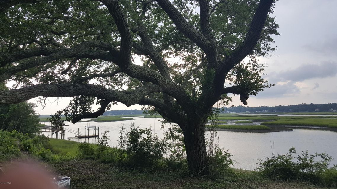 Listing Agent's opinion is there is not another prettier riverfront lot in Brunswick County. This waterfront home site has it all. Highly elevated approx. 19' above sea level. Deep-water with great fishing from your own pier(Flounder-Drum-Trout). This home-site has the most spectacular panoramic view of the widest part of the Shallotte River where it intersects with Intracoastal Waterway.Approx 115 feet on water frontage. Pier in place. Gated and private.5 min. to Holden Beach & Groc-drug store
