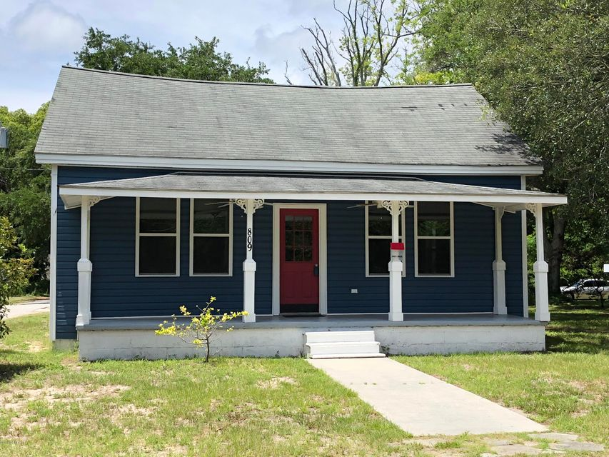 This completely updated enchanting cottage in downtown Southport will capture your heart. Large covered front porch allows for rocking chairs and relaxation. As soon as you walk in the front door you will notice the attention to details on this upgraded remodel. Open living and dining area lead to the granite pass through bar into the impeccable kitchen. Stainless appliances, tiled backsplash, and beautiful light fixtures have all been carefully chosen to accent this room. Walk in pantry allows for additional storage apart from custom cabinetry in kitchen.  Hardwood laminate throughout the home adds to the farmhouse feel along with the sliding barn doors complete with latches for the bathroom and bedrooms. Main bath offers corner set, stand-up, walk in shower as well as footed tub and dual vanity. All new fixtures throughout home as well as HVAC system, windows, electrical and plumbing, insulation, paint and flooring. Located within walking distance of downtown charm in Southport for dining, shopping, and entertainment.