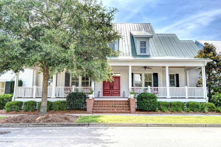 Low Country elegance with a sprawling rocking chair front porch.