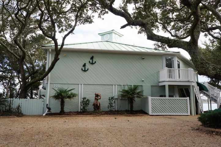 Nestled among the live oaks this home offers privacy and deep waterfrontage