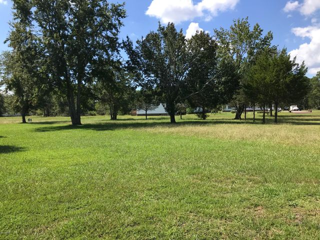 One of the few remaining residential building lots in The Village at Calabash. This view is standing on Waterview Drive and looking towards the back of the lot.