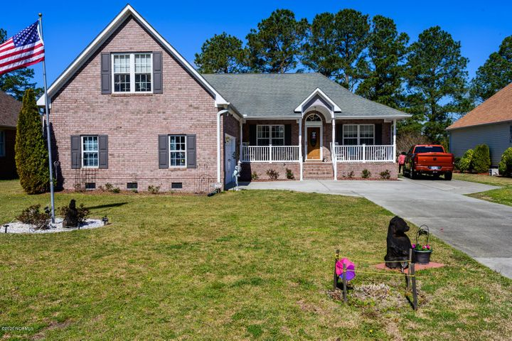 All Brick Home with 2.5 car garage. Parking on side too.