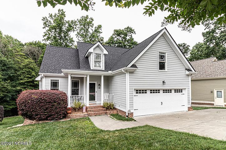 Pristine with multi-level deck overlooking private wooded tree line!