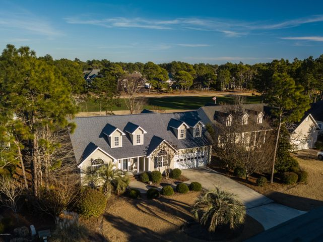 Located on the 6th Fairway of the Members Golf Course, this custom built home is centrally located to historic downtown Southport and Brunswick County's beaches while offering a retreat-like feel in this tranquil St. James neighborhood. With 3 of the 4 bedrooms on an open split floor plan, it boasts two master suites plus an additional bedroom on the first floor. The versatile loft upstairs could be transformed into an additional sleeping area, office, or playroom.  Large deck on the rear of the home and a roomy eat in kitchen allows for spacious entertaining areas while looking out over the fairway, as sunshine floods the central living spaces through the ample windows and sky lights. The St. James Plantation community has numerous amenities with ease of access to nearby destinations.